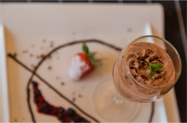 Woodapple mousse with wild berry compote